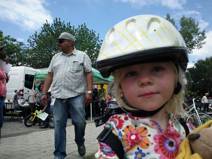 Fiona shows off her first bike helmet, Socrates Sculpture Park, Queens.