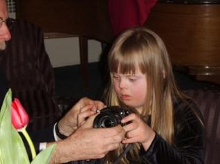 Fulton shows Amanda how to take photos.