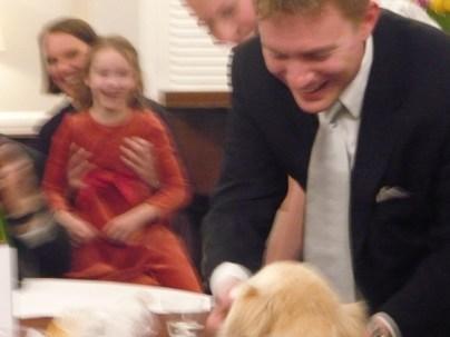 Dustin feeds Katie her cupcake as Karen and C.H.G. look on in delight.