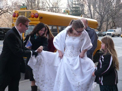 """""""That's not how you hold it!"""" MaryAnn shows Dustin how properly to hold the train of Susan's wedding dress."""