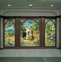These stained-glass panels, depicting the resurrected Savior with two of his disciples on the road to Emmaus, greet temple patrons as they enter through the lobby on the street level. (See Luke 24:13–32.)