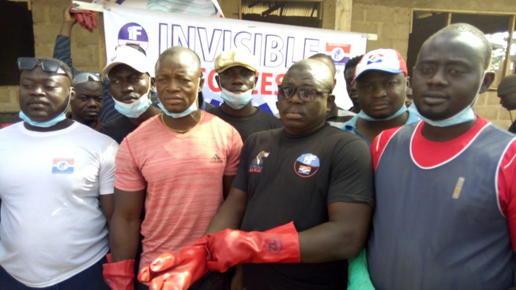 Musah M Mutala(Coolio) in red, flanked by other executives and members of the invincible forces