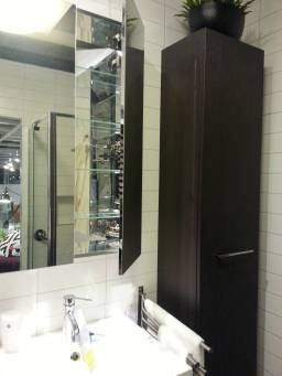Looks lovely, but it would be very frustrating to keep the inside of this mirrored cabinet clean!