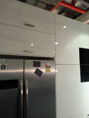 Yet another set of lift up cabinets installed too high for comfort.
