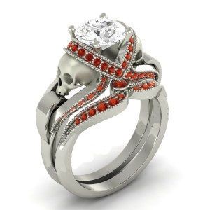 White Rounded Diamond with small rubies Skull Ring