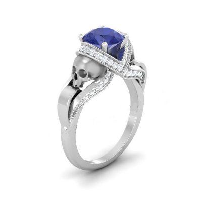 Blue & white diamond silver skull ring