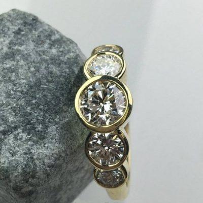 Bezel Set 1.70CT 5-Stone VVS1 Round Moissanite Engagement Ring 14K Yellow Gold Plated