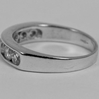 0.65 Ct Round Cut Moissanite 7-Stone Tension Set Wedding Band 925 Sterling Silver