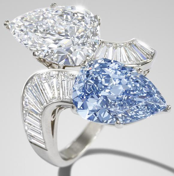 Bulgari diamond and blue diamond crossover ring, 1960. Via Diamonds in the Library.