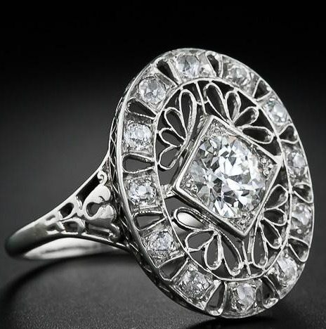 Alternate view; Edwardian diamond dinner ring at Lang Antiques. Via Diamonds in the Library.