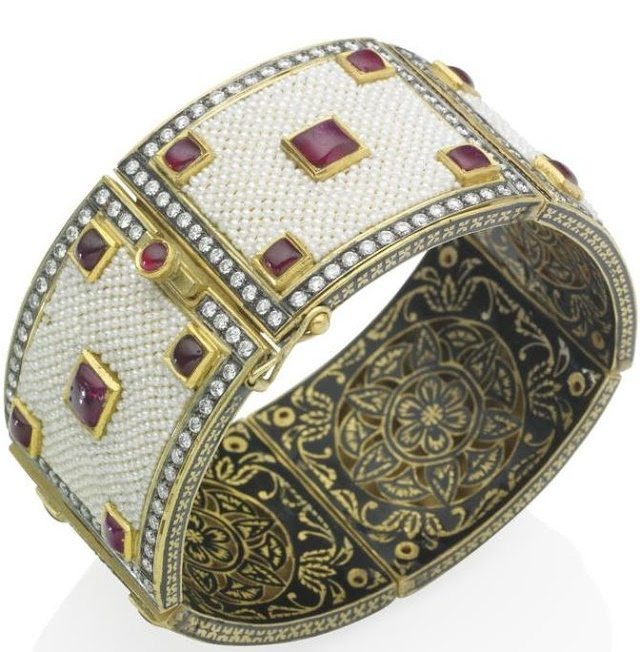 An Indian seed pearl, ruby and diamond bracelet. Via Diamonds in the Library.