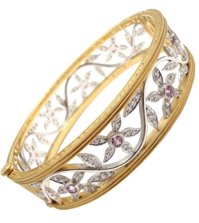 Cathy Waterman 22k gold, platinum, diamond, and pink sapphire bangle. Via Diamonds in the library.