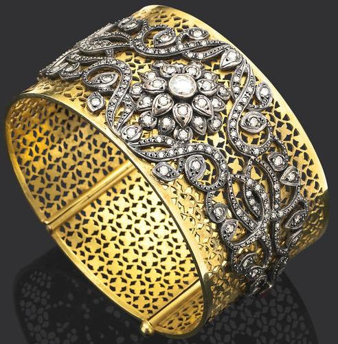 Pierced yellow gold cuff bracelet accented with a floral design in silver and diamonds. Via Diamonds in the Library.