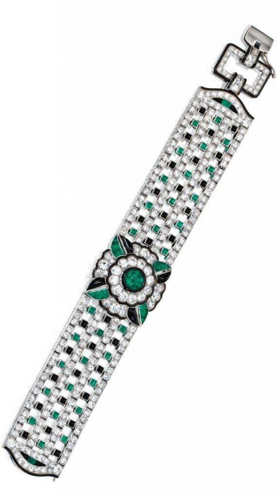 An Art Deco diamond, emerald, onyx, and enamel bracelet by Mauboussin, circa 1925. Via Diamonds in the Library.