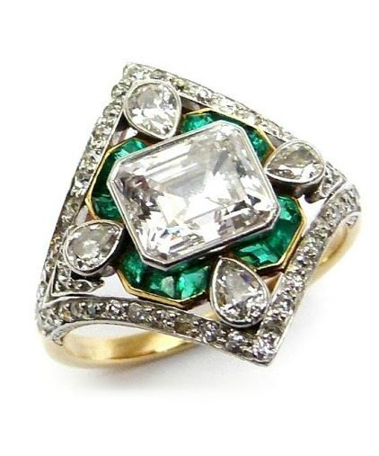 An antique Marcus and Co emerald and diamond ring, circa 1910.