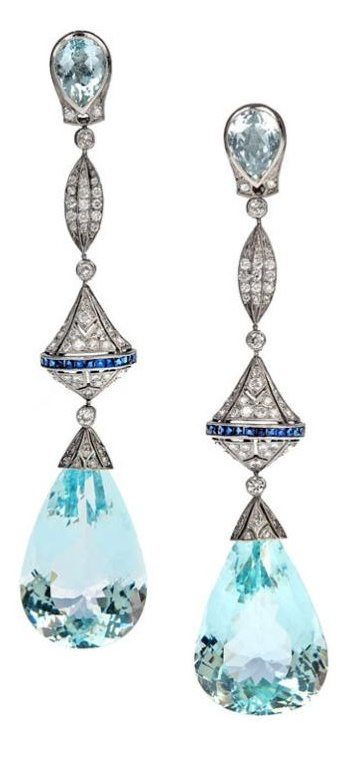 Aquamarine, diamond, sapphire, and platinum long dangle earrings. Via Diamonds in the Library.