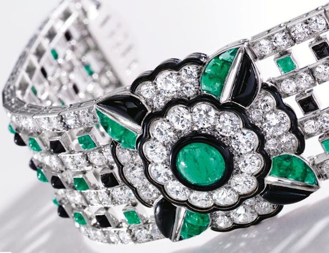Art Deco diamond, emerald, onyx, and enamel bracelet by Mauboussin, circa 1925. Via Diamonds in the Library.