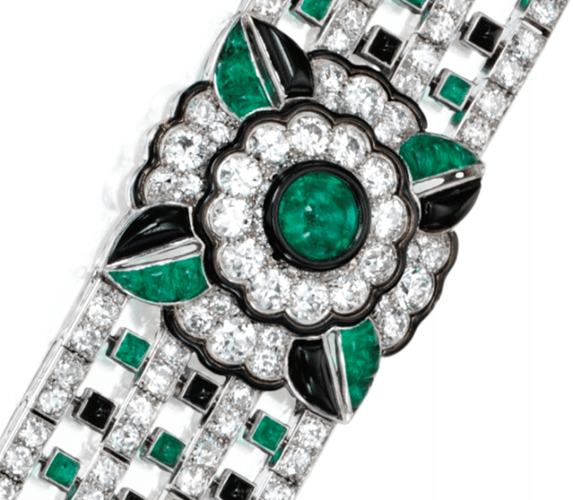 Detail; an Art Deco diamond, emerald, onyx, and enamel bracelet by Mauboussin, circa 1925. Via Diamonds in the Library.