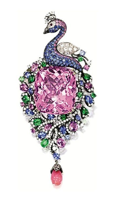 Kunzite, conch pearl, gem-set, and diamond peacock brooch pendant. The center kunzite is 46.10; plus 8.40 carats of tsavorite garnets, sapphires, and pink sapphires; and 1.20 carats of diamonds.