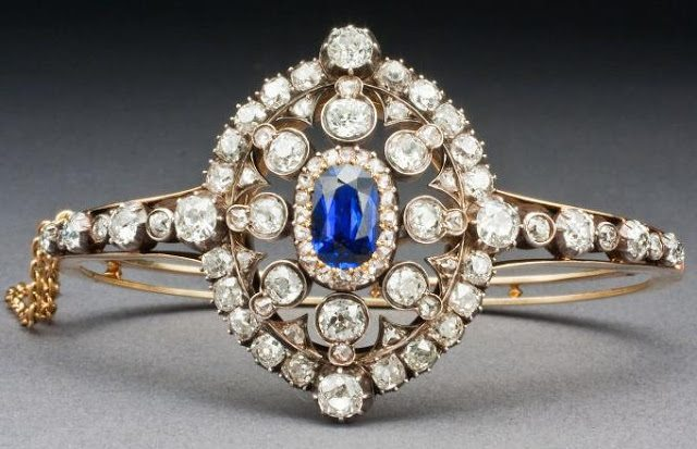 Victorian Hunt & Roskell sapphire and diamond bracelet, circa 1880. Set with an oval-cut royal blue Burmese sapphire and a cluster of old European-cut and rose-cut diamonds. Converts to a brooch.