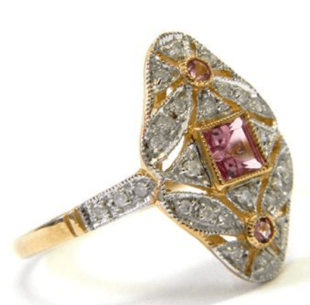 A pink tourmaline and diamond ring, listed on eBay by Dover Jewelry. Via Diamonds in the Library.