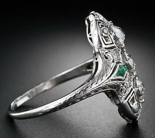 Antique Art Deco diamond calibre emerald dinner ring, circa 1930's. Via Diamonds in the Library.