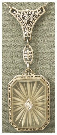 Art Deco 14K Gold, Diamond Camphor Glass Pendant Necklace. Via Diamonds in the Library.