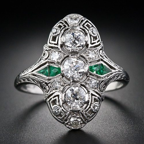 Art Deco diamond calibre emerald dinner ring, circa 1930's. Via Diamonds in the Library.