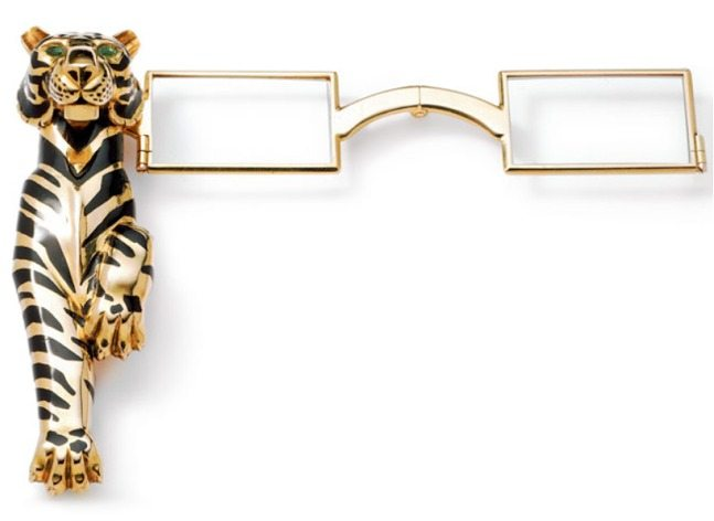The Duchess of Windsor's Tigre lorgnette, made by Cartier Paris in 1954, by special order. The tiger is gold, striped with black champlevé enamel, and set with emeralds.