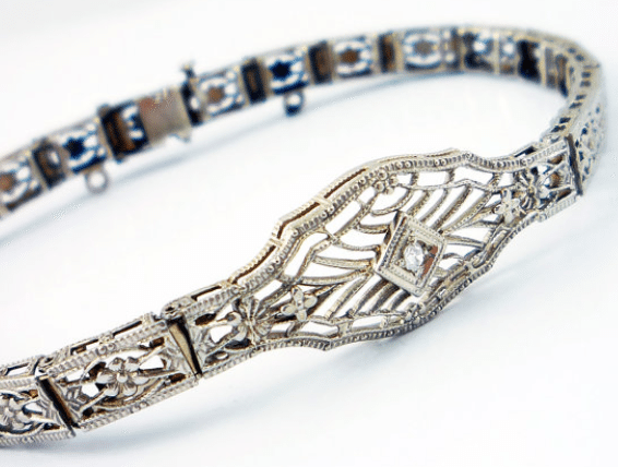 10K Belais Brothers white gold antique Art Deco diamond filigree bracelet. Via Diamonds in the Library.