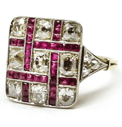 Antique gold and silver mounted lattice work French-cut ruby and diamond square cluster ring. Via Diamonds in the Library.