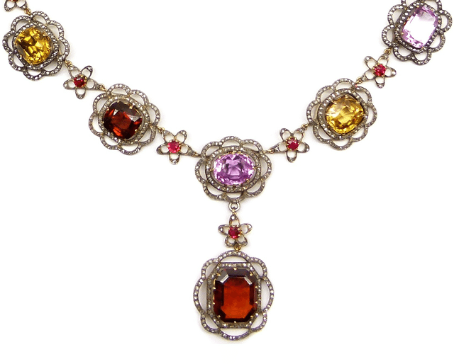 Detail; 19th century gem and diamond necklace with rubies, garnets, white sapphires, aquamarines, yellow zircons, pink topaz, peridot, tourmaline, and orange topaz.