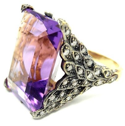 A beautiful Cathy Waterman gold, diamond and amethyst winged ring. Via Diamonds in the Library.
