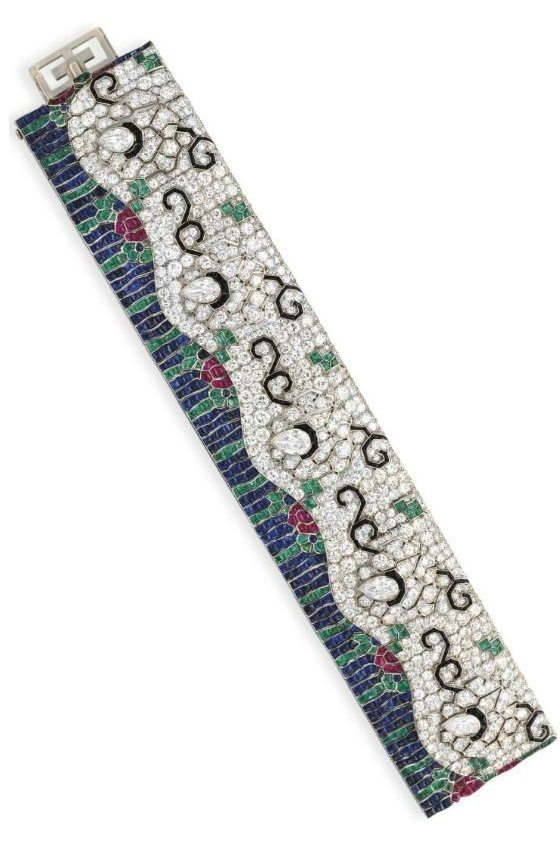 Art Deco diamond and multi-gem wave bracelet by Rubel Freres. Circa 1925. Via Diamonds in the Library.