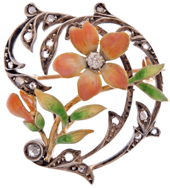 Art Nouveau diamond and enamel flower brooch, circa 1915. Via Diamonds in the Library.