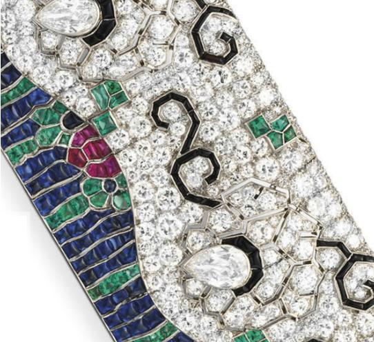 Detail; Art Deco diamond and multi-gem wave bracelet by Rubel Freres. Circa 1925. Via Diamonds in the Library.