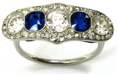 Early 20th century sapphire and diamond five stone line half hoop cluster ring, circa 1910. Via Diamonds in the Library.