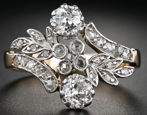 Edwardian twin-stone diamond ring. Via Diamonds in the Library.