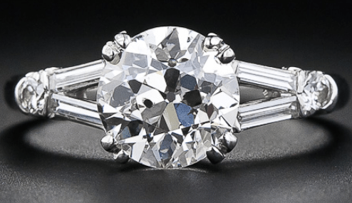 Mid-century 2.01 carat diamond engagement ring. Via Diamonds in the Library.