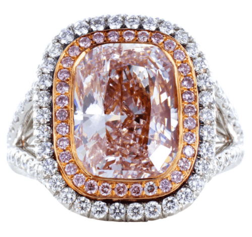 4.36 carat pink diamond ring with an additional 1.08 carats of colorless and pink full cut round diamonds. Via Diamonds in the Library.