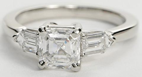 Blue Nile's tapered bullet engagement ring with a 1 carat Asscher-cut diamond. Via Diamonds in the Library.