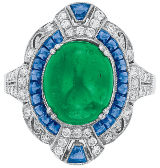 Cabochon emerald, diamond, and sapphire ring. Via Diamonds in the Library.