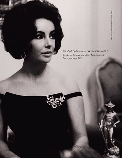 Elizabeth Taylor looking glamorous in the brooch and earrings from her Bulgari emerald and diamond suite. Via Diamonds in the Library.