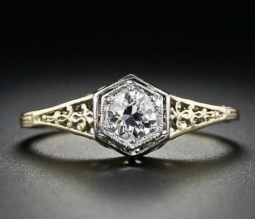 Front view; a vintage diamond filigree engagement ring. Via Diamonds in the Library.