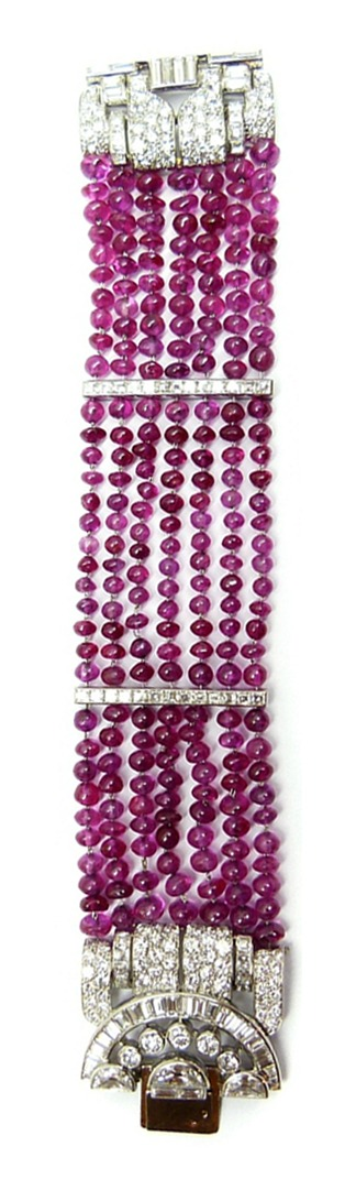 Long view of Art Deco ruby bead and diamond cluster bracelet by Van Cleef & Arpels. Circa 1934. Via Diamonds in the Library.
