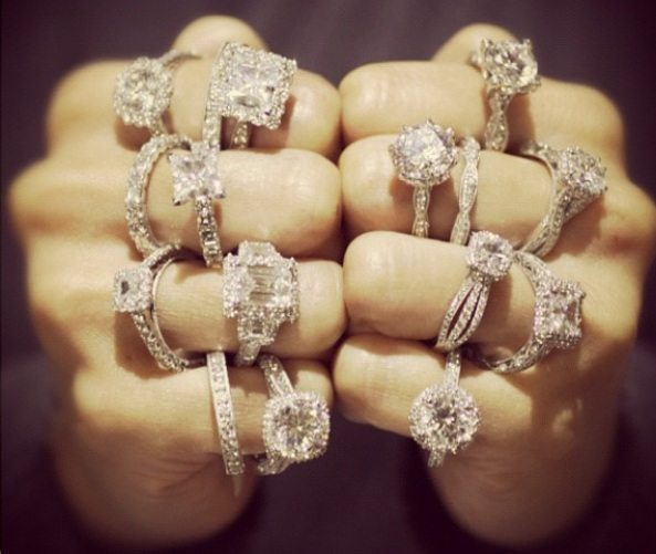 Two lucky hands full of Tacori engagement rings. Via Diamonds in the Library.
