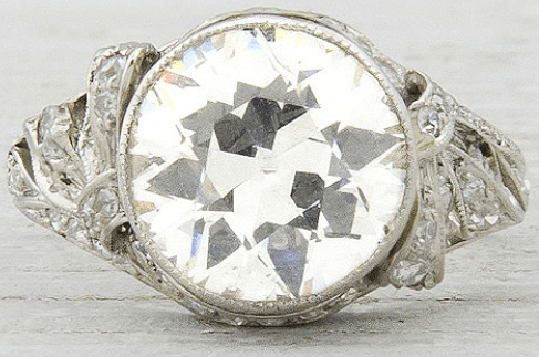 Antique Edwardian or early Art Deco engagement ring, circa 1905. Set with 2.33 carat old European cut diamond with H-I color and SI1 clarity. Via Diamonds in the Library.