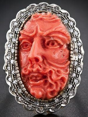 Antique Italian carved coral and diamond ring; front view. Via Diamonds in the Library.