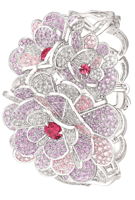 Camélia Origami bracelet from the Chanel Jardin de Camélias collection. White gold set with diamonds, pink and purple sapphires, and pink spinels. Via Diamonds in the Library.