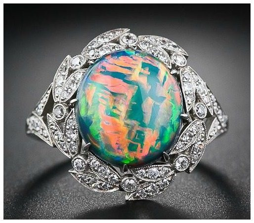Fire opal and diamond ring. Via Diamonds in the Library.
